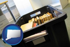 ct map icon and a moving box in an empty office, during a relocation project