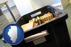 il map icon and a moving box in an empty office, during a relocation project