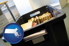 ma map icon and a moving box in an empty office, during a relocation project