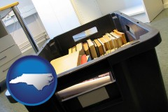 nc map icon and a moving box in an empty office, during a relocation project