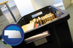 ne map icon and a moving box in an empty office, during a relocation project