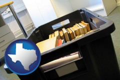 tx map icon and a moving box in an empty office, during a relocation project