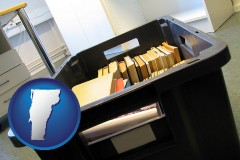 vt map icon and a moving box in an empty office, during a relocation project