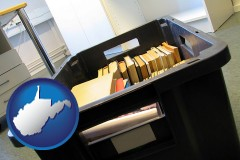 wv map icon and a moving box in an empty office, during a relocation project