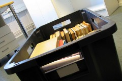 a moving box in an empty office, during a relocation project