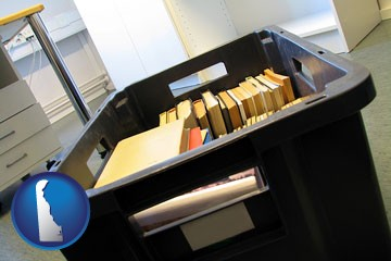 a moving box in an empty office, during a relocation project - with Delaware icon