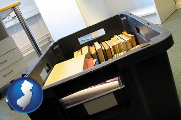 a moving box in an empty office, during a relocation project - with New Jersey icon