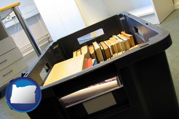 a moving box in an empty office, during a relocation project - with Oregon icon